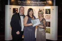 Karen Wiltshire holding photographer of the year title