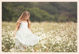 Long haired girl in wild daisies