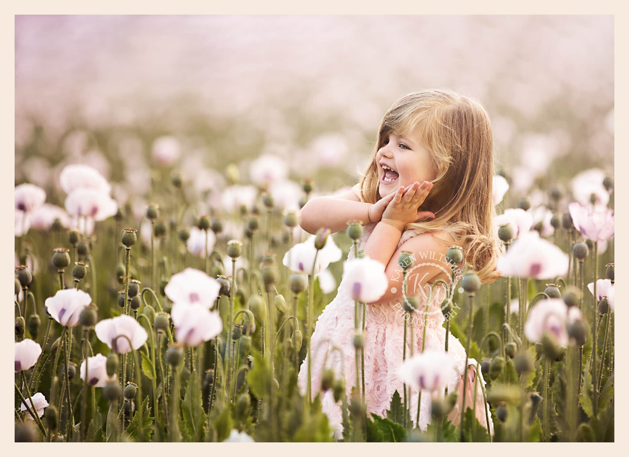 Girl laughing in purple poppies