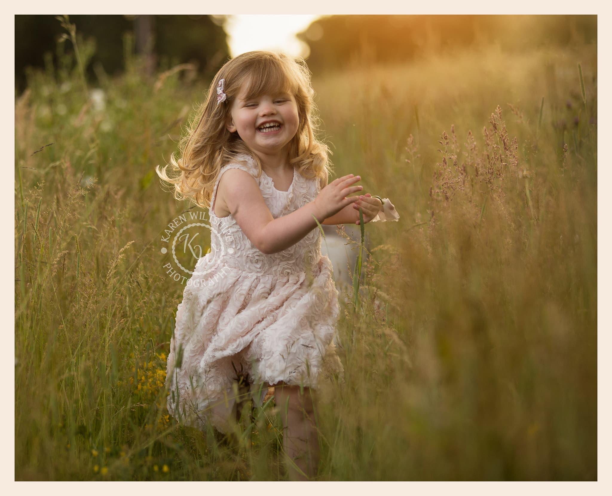 Girl running in long grass