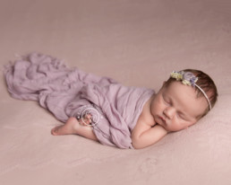 Baby asleep on a pink blanket