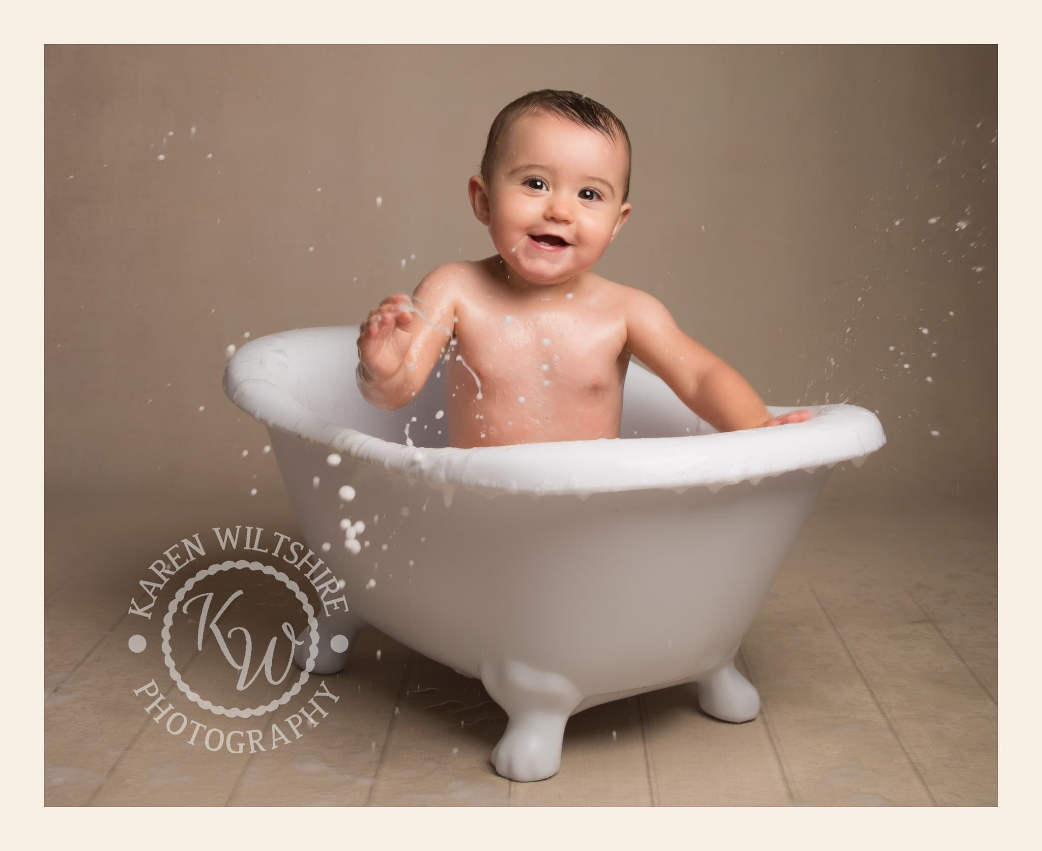 Baby Splashing in bath
