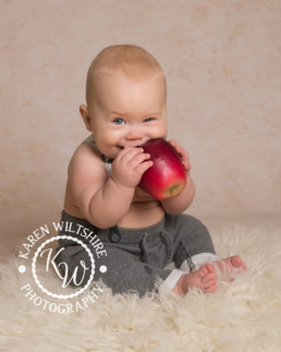cubby baby eating and apple