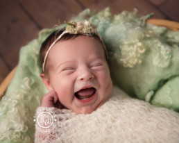 newborn baby smiling