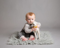 baby with toy dog at his Baby photoshoot with KW Photography