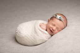 Baby girl smiling whilst sleeping