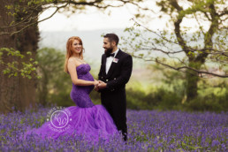Parents to be in bluebell woods