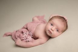 Newborn baby girl wide eyed and wake