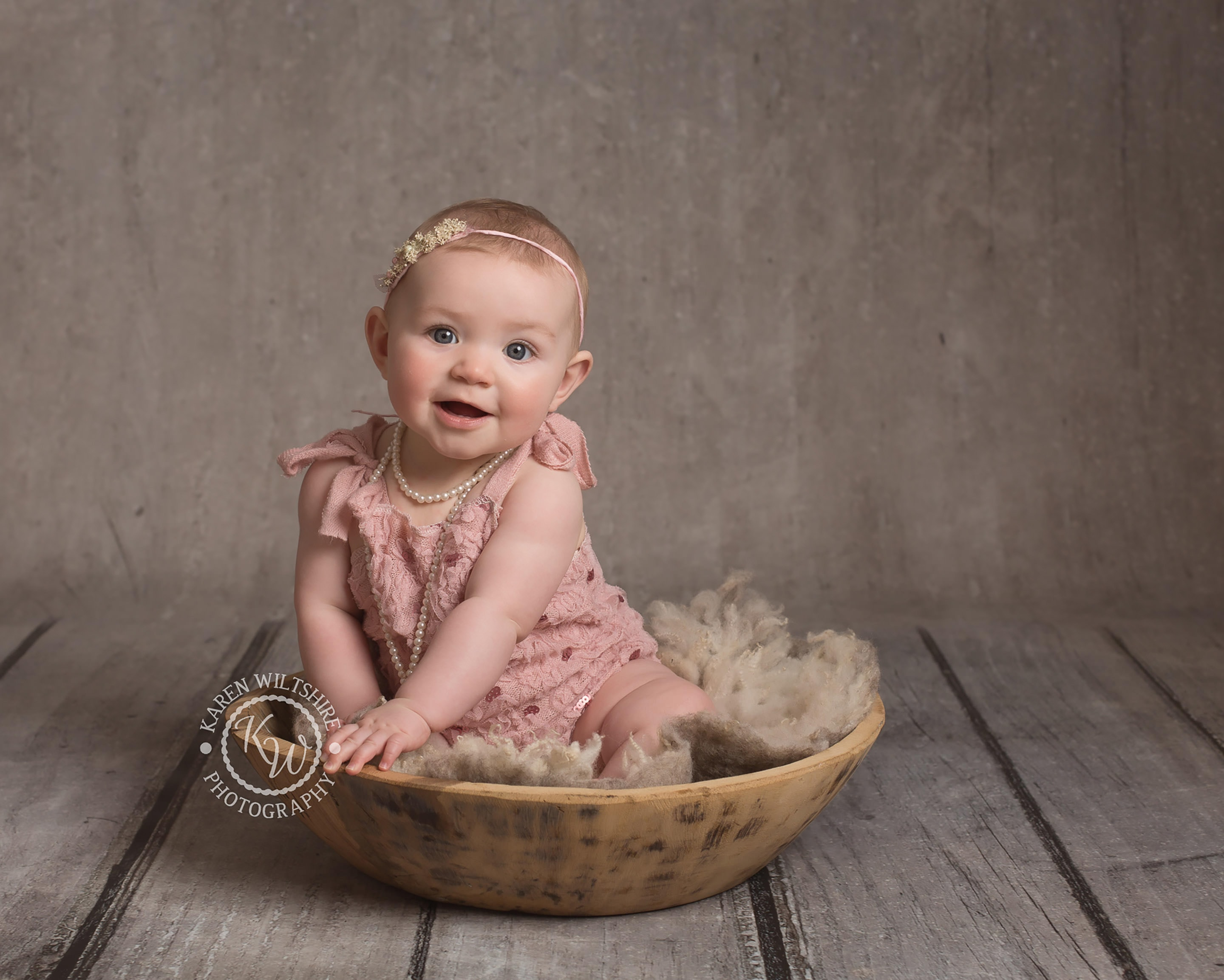 children & baby photography,cute baby in pink outfit smiling at the camera