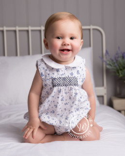 happy baby on a bed children & baby photography poole dorset