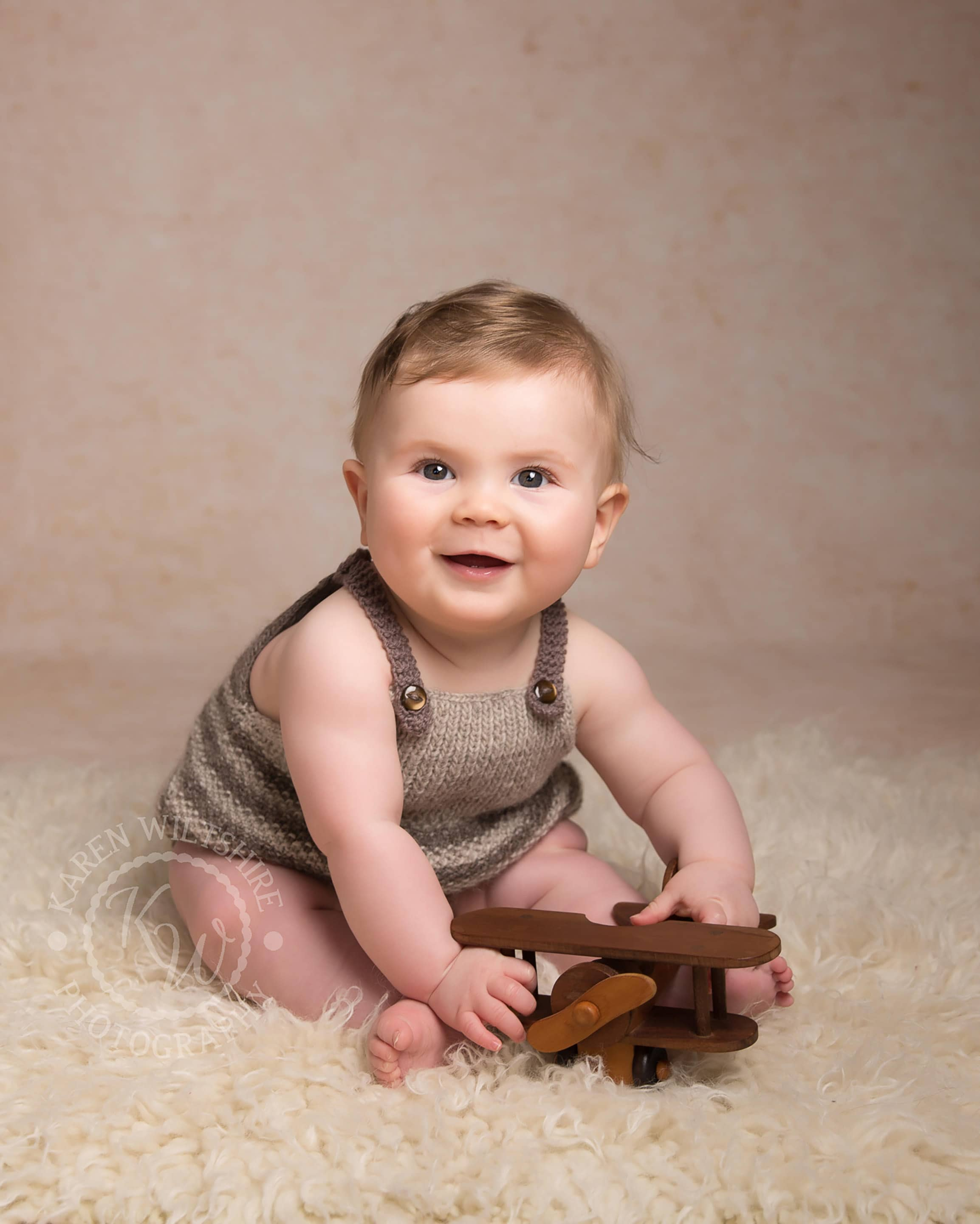 baby photography, boy sitting on fur rug