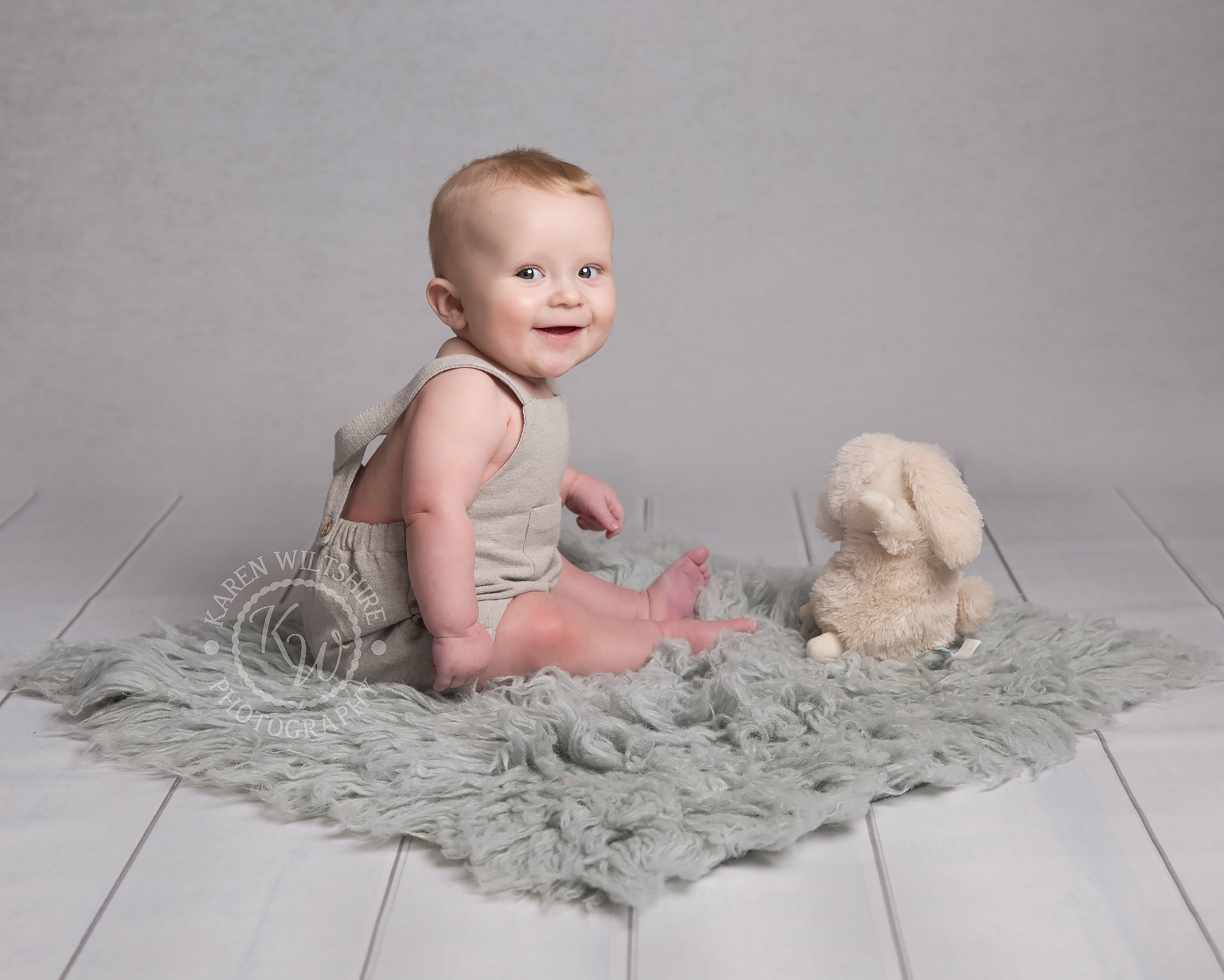 children & baby photography, Bunny toy and sitting baby playing