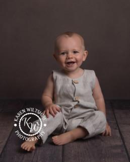 baby boy in linen romper