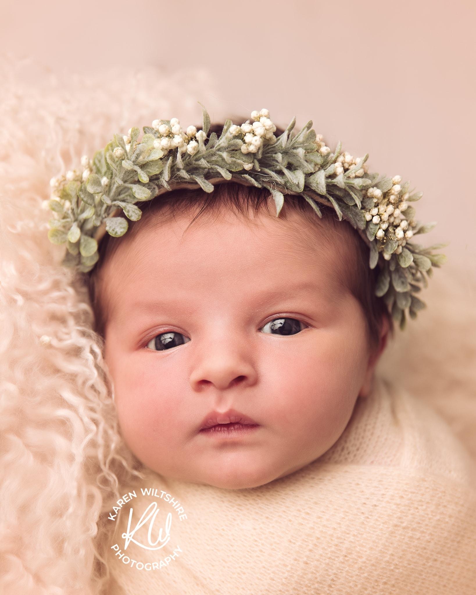 wide awake newborn Baby in headband