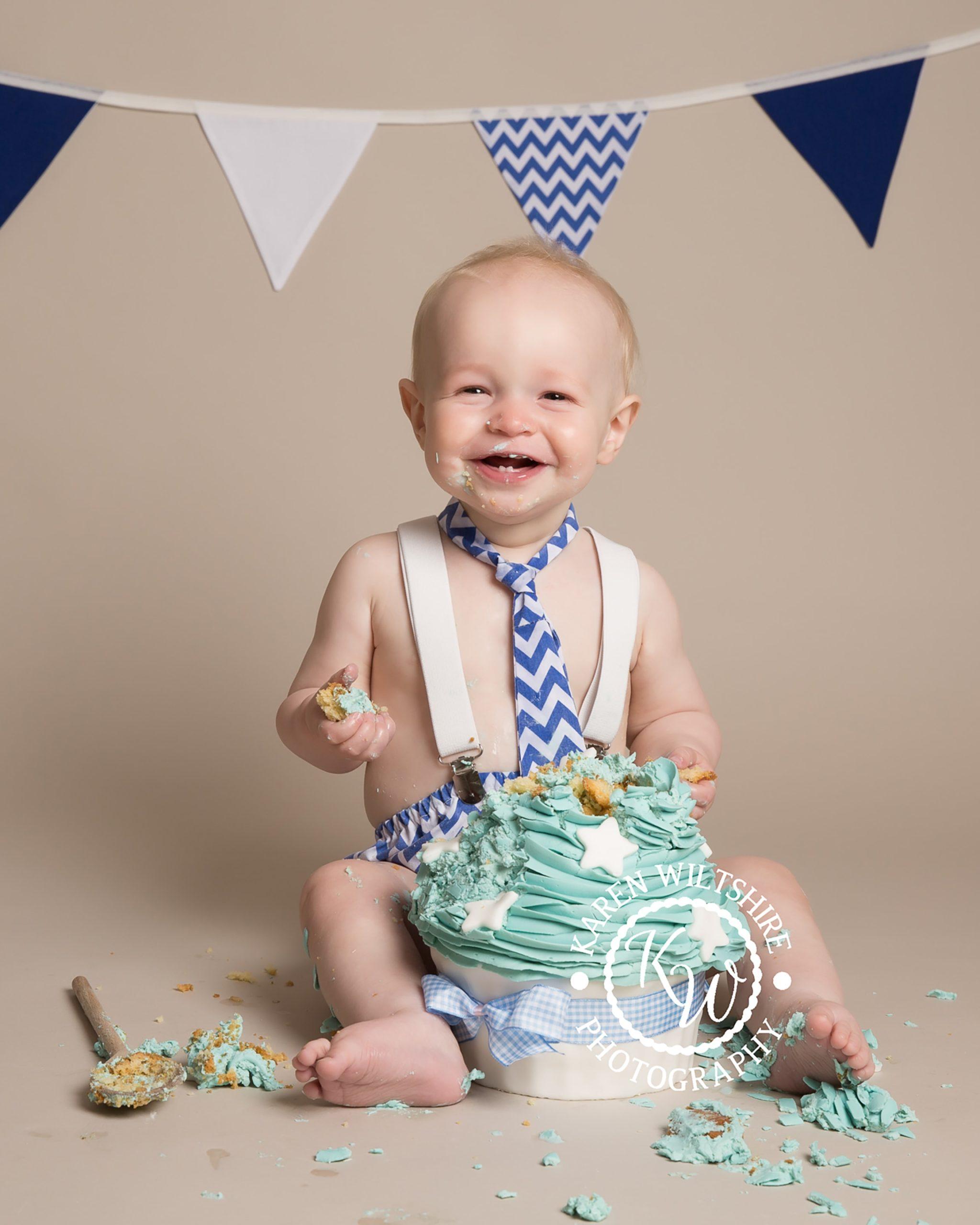 Smiling baby boy cake smash