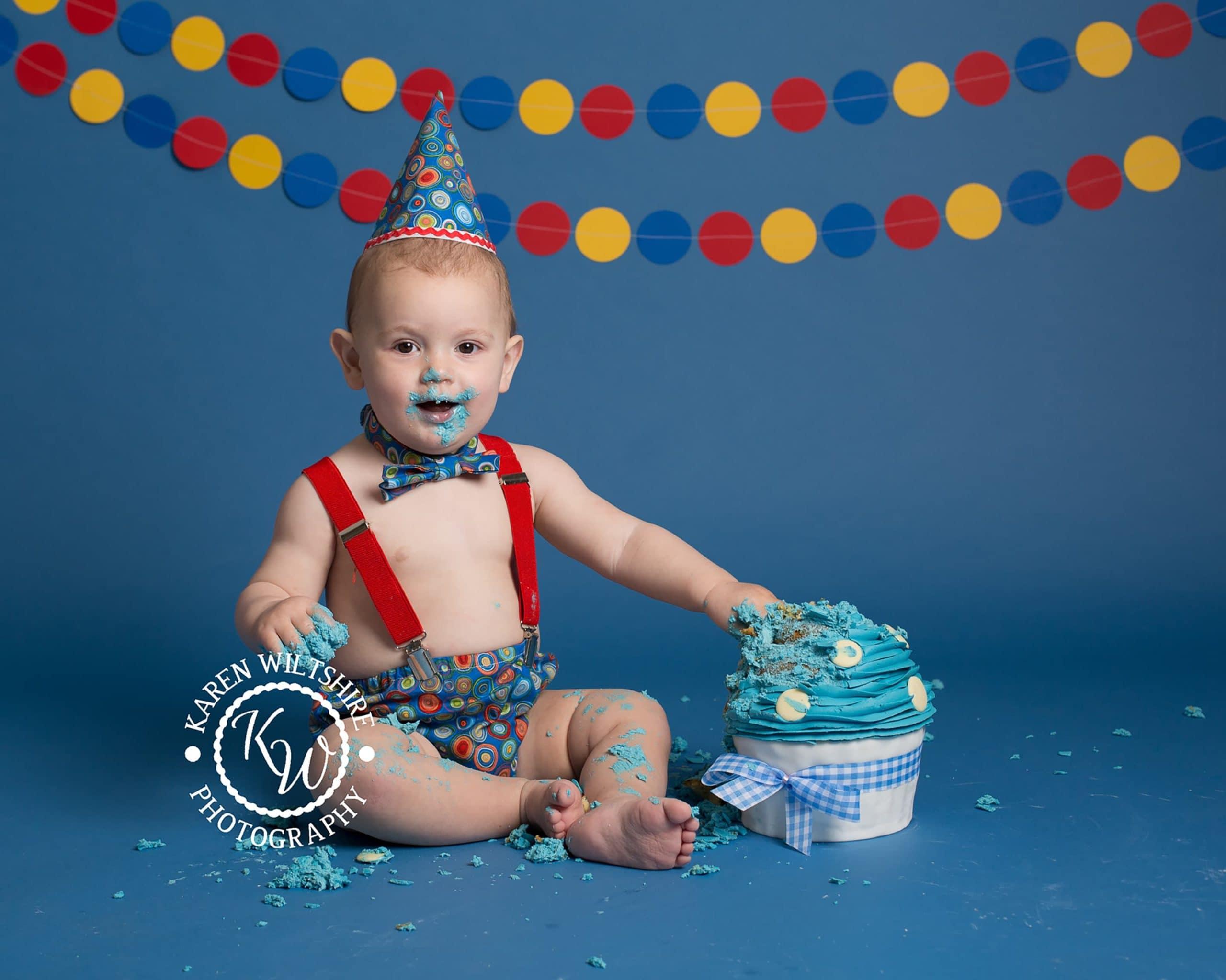 Boys smash the cake session on a blue background