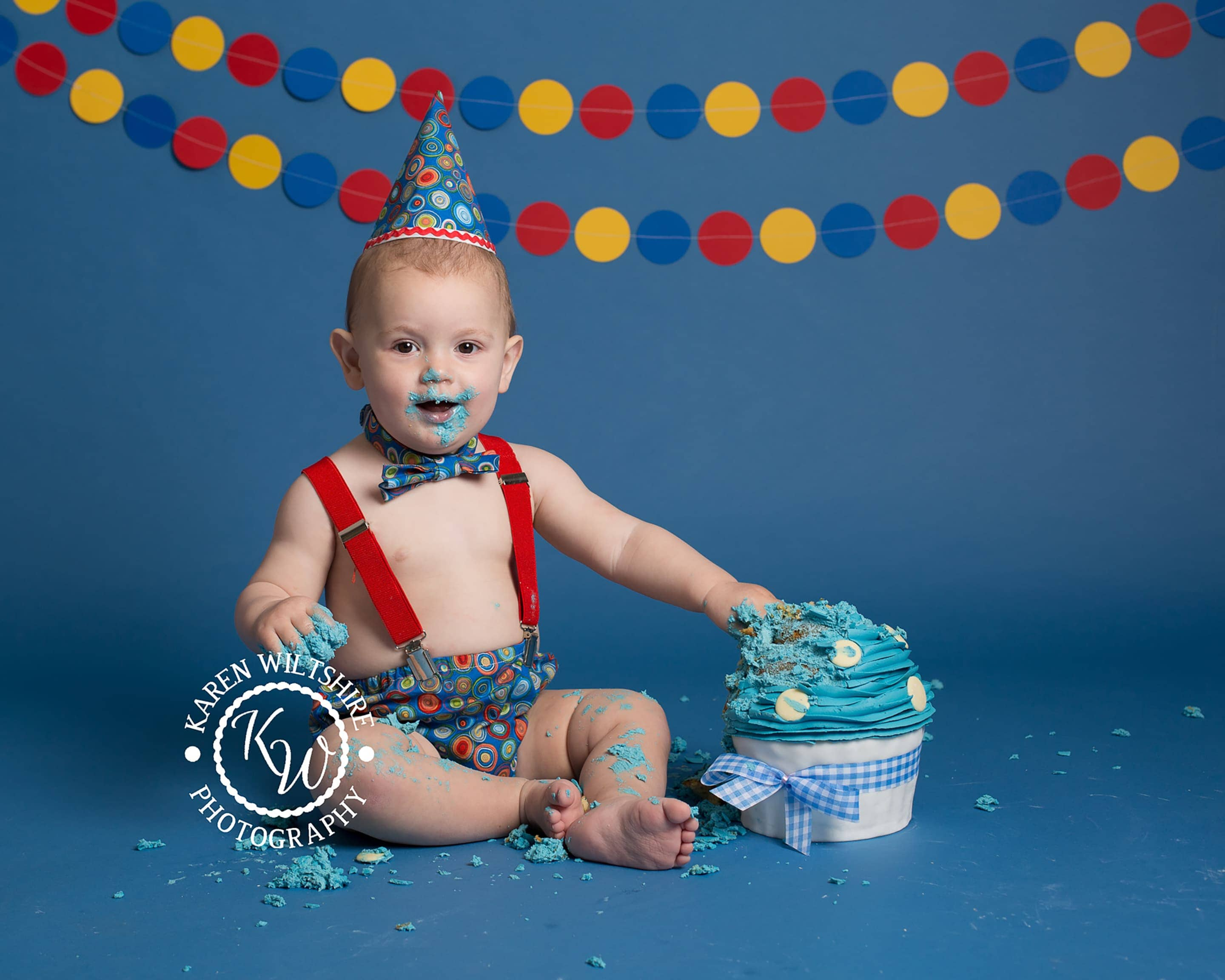 Boys smash the cake session on a blue background