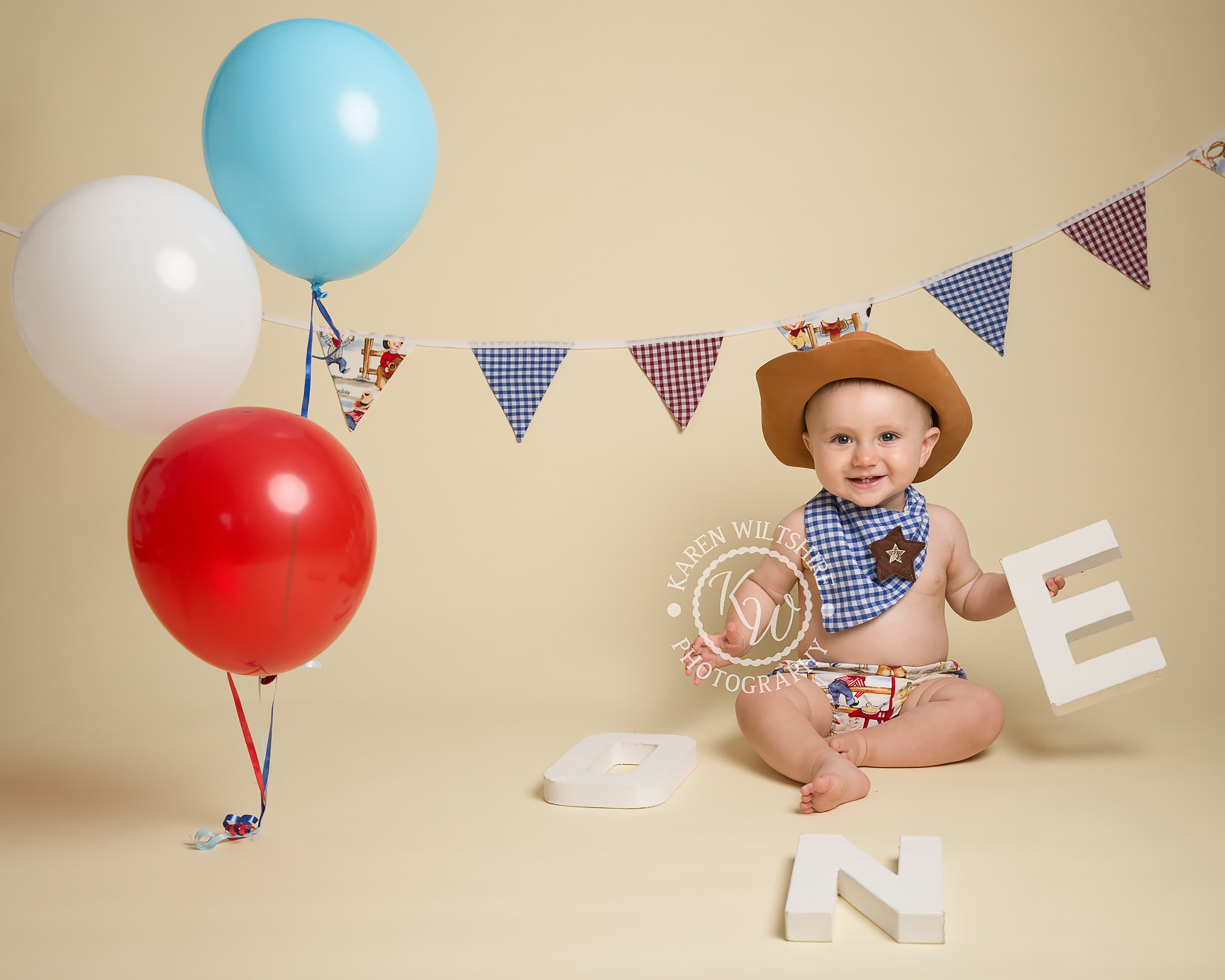 Baby boys cake smash with a cowboy theme