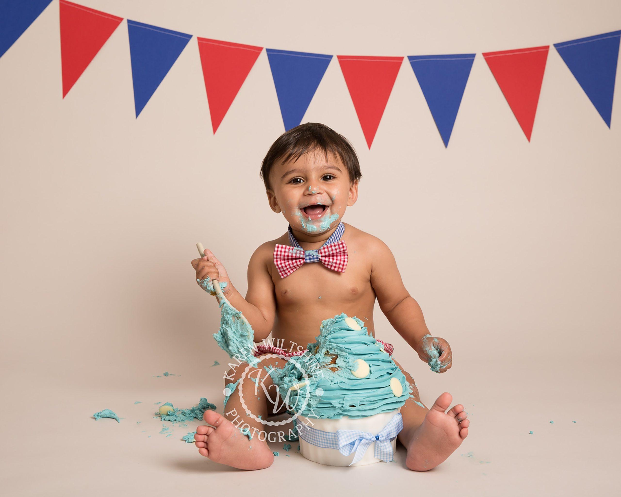 fun baby photo shoot with cake