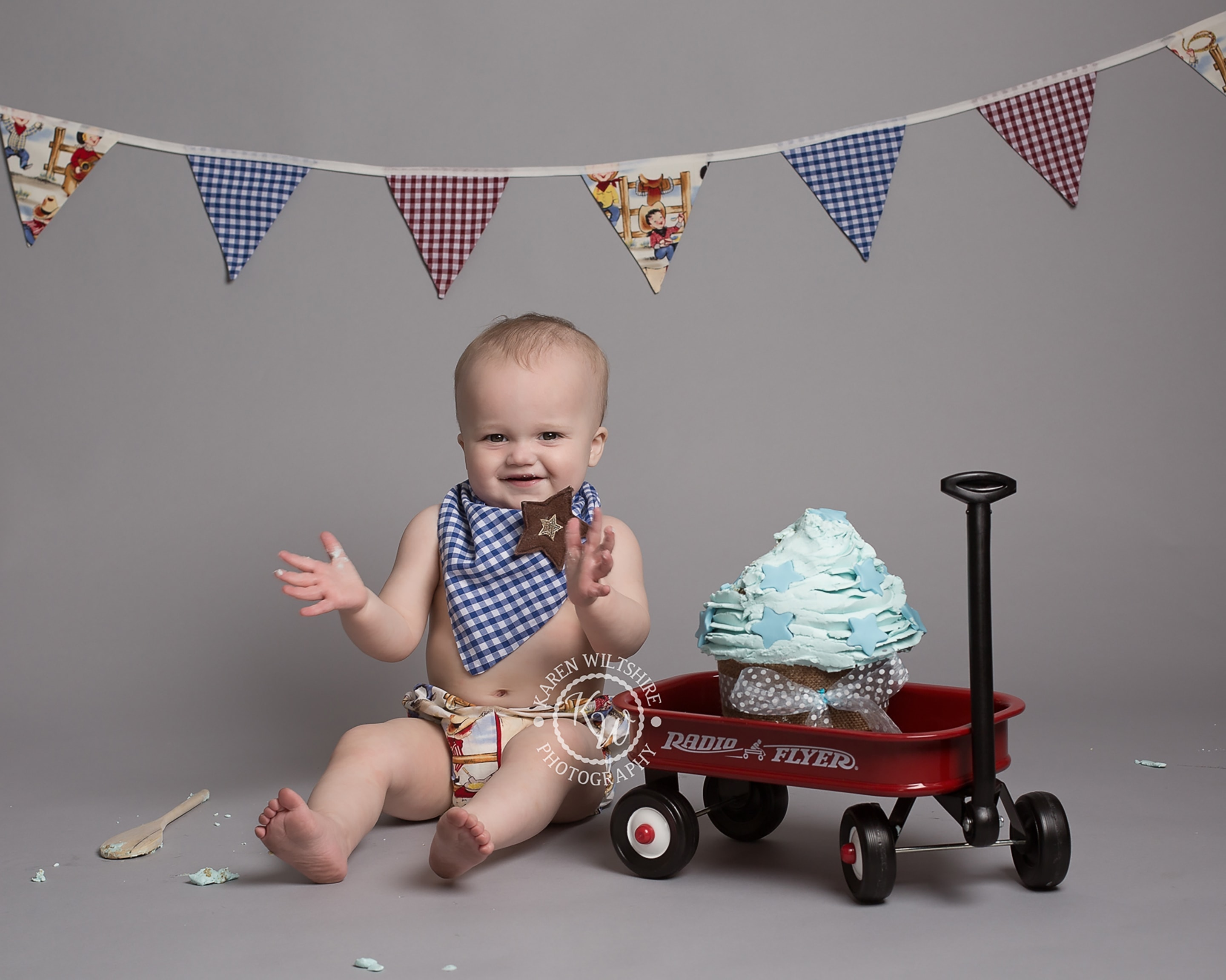 Baby boy cake smash with a red and blue theme