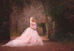 pregnant lady in pink tutu outside in nature