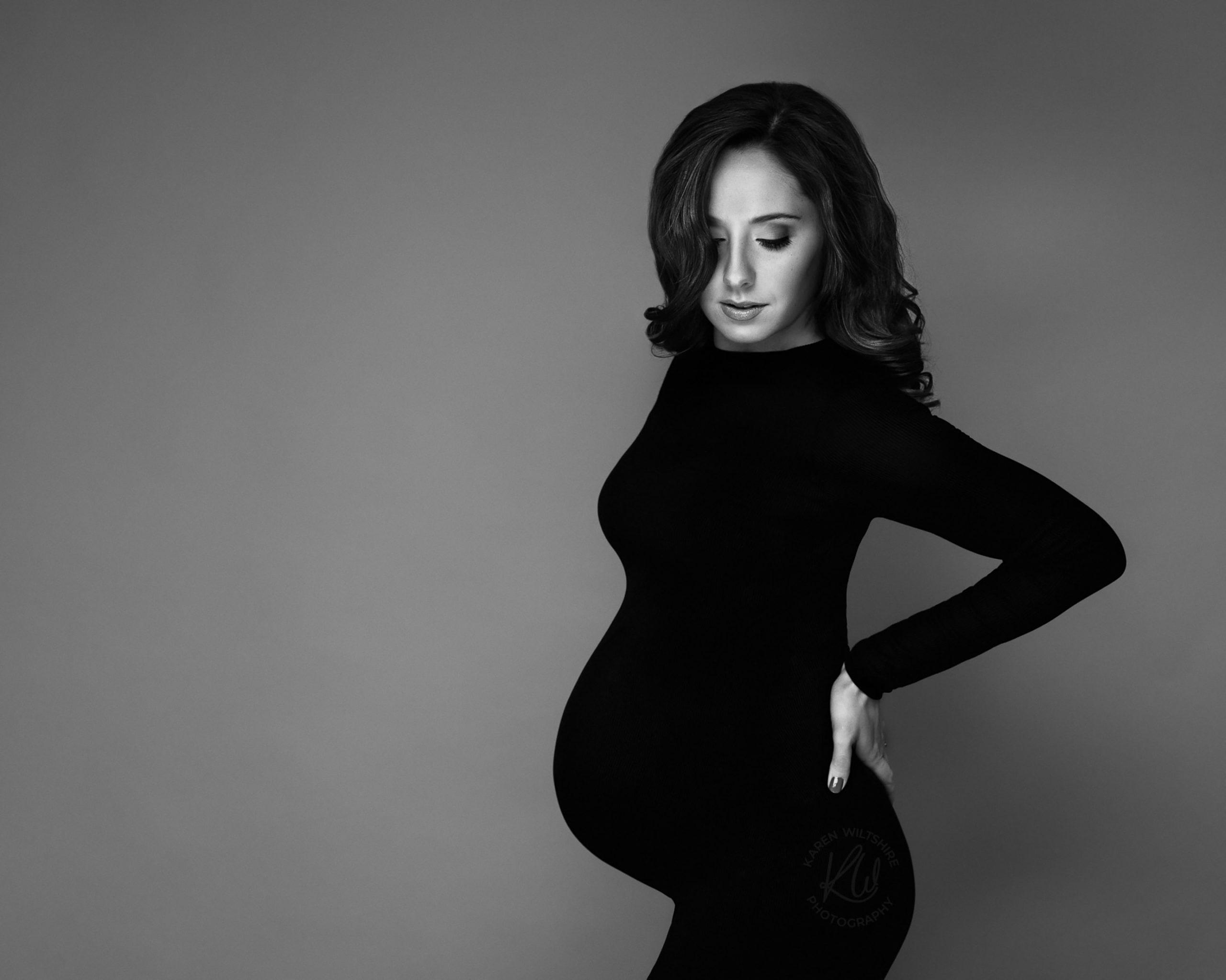 pregnant lady posing for bump photos