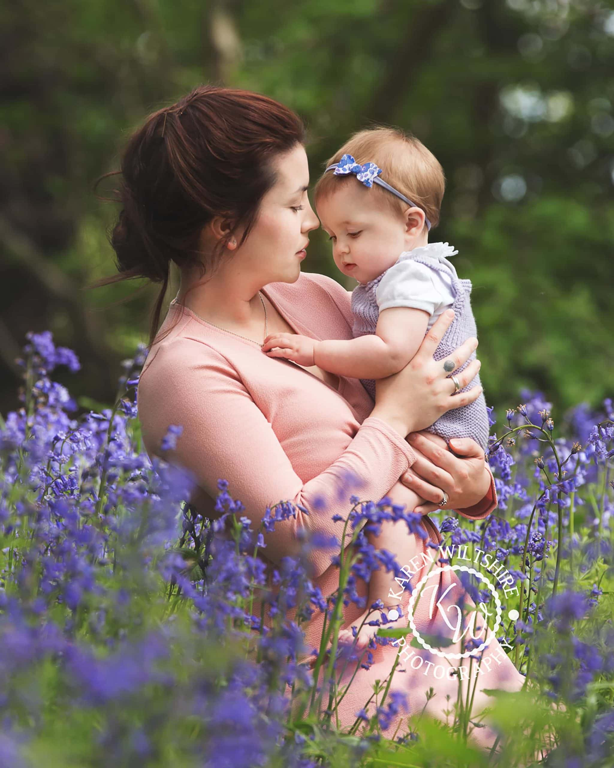 mother and baby in bluebell woods