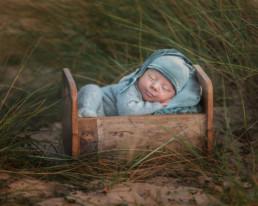 Baby sleeping on Poole beach