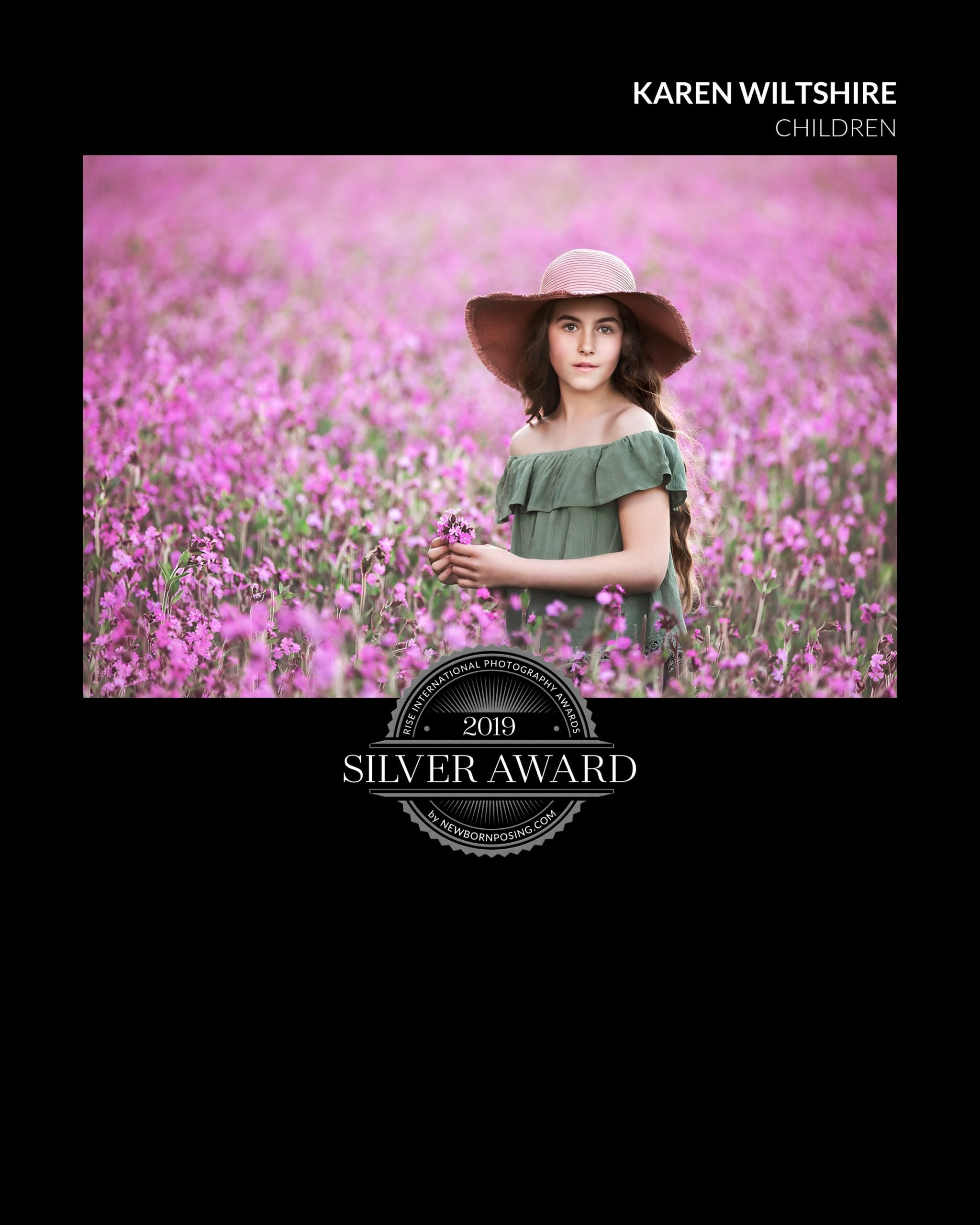 girl in hat wondering though a wildflower field